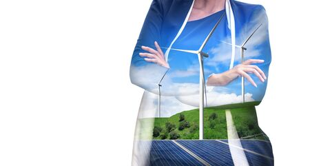 Double exposure graphic of business people working over wind turbine farm and green renewable energy worker interface. Concept of sustainability development by alternative energy. Archivio Fotografico
