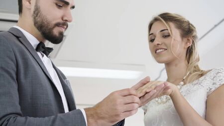 Happy bride and groom in wedding dress prepare for married in wedding ceremony. Romantic love of man and woman couple. 写真素材