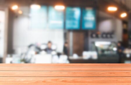 Wood table in blurry background of modern restaurant room or coffee shop with empty copy space on the table for product display mockup. Interior restaurant counter design concept. Stok Fotoğraf