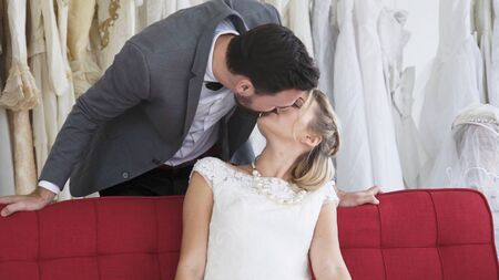 Happy bride and groom in wedding dress prepare for married in wedding ceremony. Romantic love of man and woman couple. Zdjęcie Seryjne