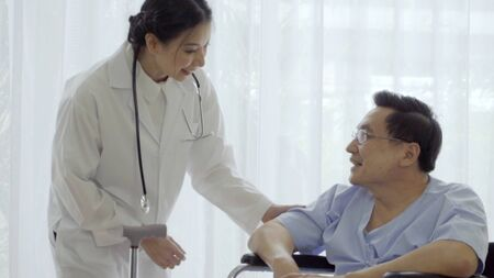 Doctor or physician take care of sick patient at the hospital or medical clinic. The happy patient visit doctor and discuss for illness cure treatment. Medical healthcare and doctor service concept. Stock Photo