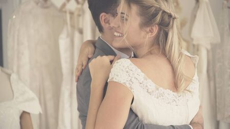 Happy bride and groom in wedding dress prepare for married in wedding ceremony. Romantic love of man and woman couple. Reklamní fotografie - 130551561