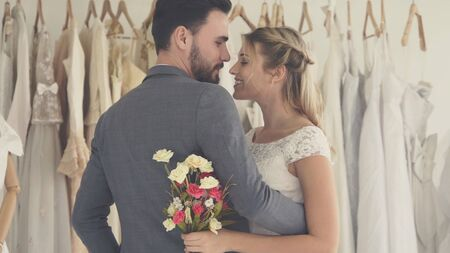 Happy bride and groom in wedding dress prepare for married in wedding ceremony. Romantic love of man and woman couple. Reklamní fotografie