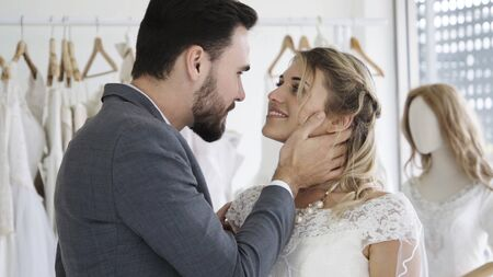 Happy bride and groom in wedding dress prepare for married in wedding ceremony. Romantic love of man and woman couple. Stock Photo