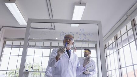 Scientist work with science equipment in laboratory. Scientific experiment and education for research development concept. Stock Photo
