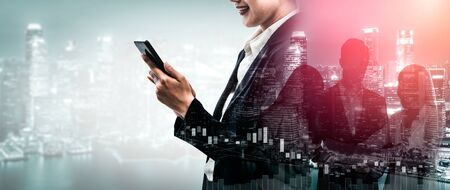 Double Exposure Image of Business Communication Network Technology Concept - Business people using smartphone or mobile phone device on modern cityscape background. Banco de Imagens