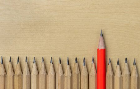 Different pencil standout from the others showing concept of unique business thinking different from the crowd and special one with leadership skill.