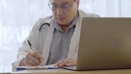 Doctor working with patient health data in the hospital office. Medical service and healthcare concept. Reklamní fotografie