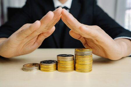 Businessman working with coin money currency. Concept of investment growth and money saving.