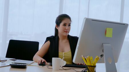 Businesswoman using desktop computer in office. Business concept.