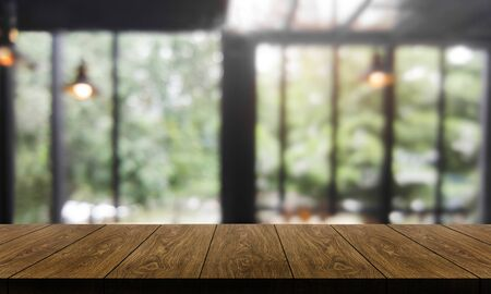Wood table in blurry background of modern restaurant room or coffee shop with empty copy space on the table for product display mockup. Interior restaurant counter design concept. Stock fotó