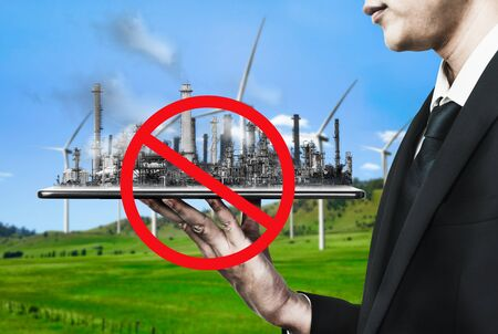 Ban of air pollution from conventional power industry causes problem to world environment such as global warming. Concept of change and disruption to the era of old toxic polluting factory. Stock Photo