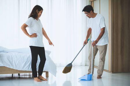 Asian senior couple cleaning bedroom floor. Retirement and healthy elderly concept. Archivio Fotografico