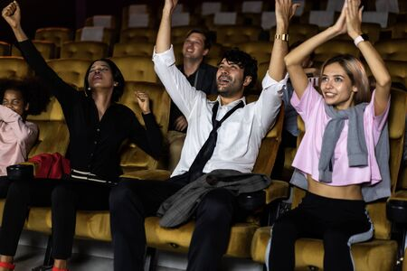 Audience is happy and exciting in movie theater cinema. Group recreation activity and entertainment concept.
