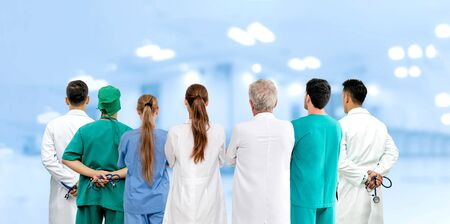 Healthcare profession teamwork and doctor service concept - International medical staff group of doctors, nurses and surgeon specialist standing with stethoscopes in the hospital. Reklamní fotografie