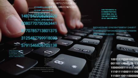 Man working on laptop computer keyboard with graphic user interface GUI hologram showing concepts of big data science technology, digital network connection and computer programming algorithm. Stock Photo