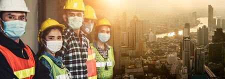 Factory workers with face mask protect from outbreak of Corona Virus Disease 2019 or COVID-19. Stock Photo