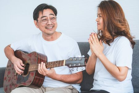 Happy Asian senior couple having good time at home. Old people retirement and healthy citizens elderly concept. Stockfoto