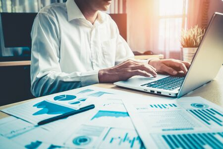 Businessman accountant or financial expert analyze business report graph and finance chart at corporate office. Concept of finance economy, banking business and stock market research. Foto de archivo