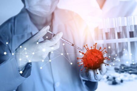 Coronavirus COVID-19 medical test vaccine research and development concept. Scientist in laboratory study and analyze scientific sample of Coronavirus antibody to produce drug treatment for COVID-19. Standard-Bild