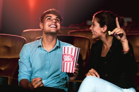 Man and woman watching movie in the movie theater cinema. Group recreation activity and entertainment concept. 版權商用圖片 - 148159002