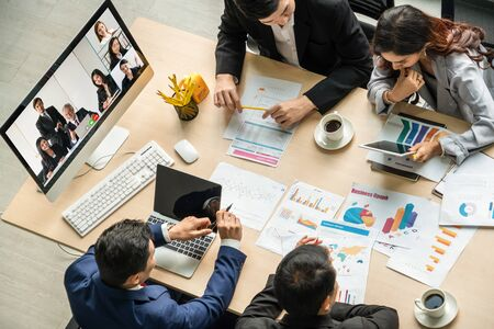 Video call group business people meeting on virtual workplace or remote office. Telework conference call using smart video technology to communicate colleague in professional corporate business. Stock Photo