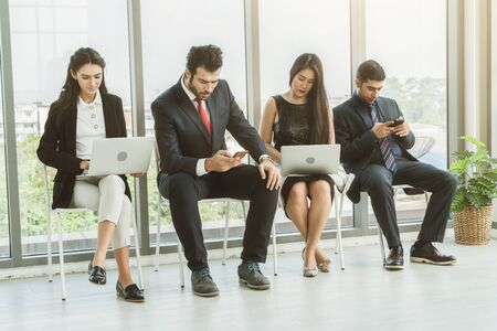 Job seekers and applicants waiting for interview on chairs in office. Job application and recruitment interview qualification concept.