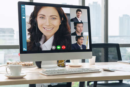 Video call business people meeting on virtual workplace or remote office. Telework conference call using smart video technology to communicate colleague in professional corporate business. Stockfoto