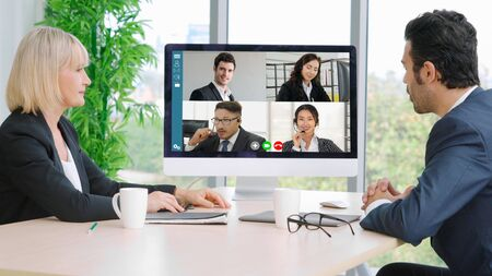 Video call group business people meeting on virtual workplace or remote office. Telework conference call using smart video technology to communicate colleague in professional corporate business. Banque d'images