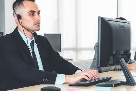 Business people wearing headset working in office Stock Photo