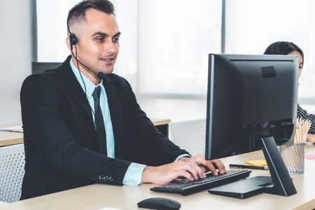 Business people wearing headset working in office Imagens