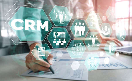 CRM Customer Relationship Management for business sales marketing system concept presented in futuristic graphic interface of service application to support CRM database analysis.