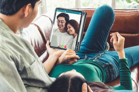Family happy video call while stay safe at home during covid-19 coronavirus Stok Fotoğraf