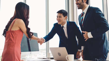Job seeker and manager handshake in job interview meeting at corporate office. The young interviewee seeking for a professional career job opportunity . Human resources and recruitment concept.