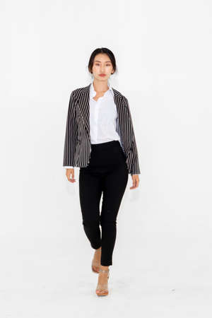 Asian woman full body portrait on white background wearing formal business suit . Imagens