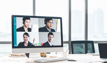 Video call business people meeting on virtual workplace or remote office. Telework conference call using smart video technology to communicate colleague in professional corporate business. Zdjęcie Seryjne