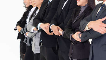 Successful business people standing together showing strong relationship of worker community. A team of businessman and businesswoman expressing a strong group teamwork at the modern office. 版權商用圖片