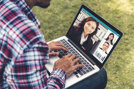 Video call business people meeting on virtual workplace or remote office. Telework conference call using smart video technology to communicate colleague in professional corporate business. Banco de Imagens