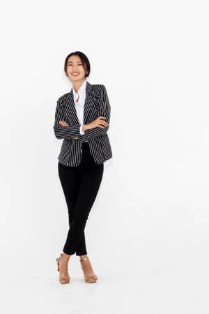 Asian woman full body portrait on white background wearing formal business suit .