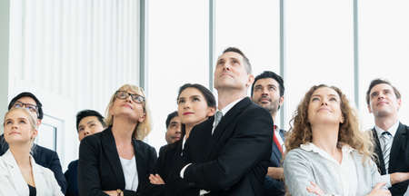 Successful business people standing together showing strong relationship of worker community. A team of businessman and businesswoman expressing a strong group teamwork at the modern office.