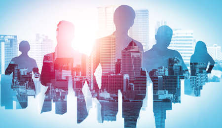 Abstract image of many business people together in group on background of city view with office building showing partnership success of business deal. Concept of employee teamwork, trust and agreement