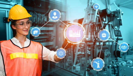 Engineering technology and industry 4.0 smart factory concept with icon graphic showing automation system by using robots and automated machinery controlled via internet network . Archivio Fotografico