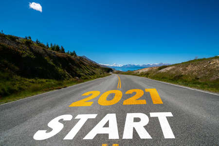 2021 New Year road trip travel and future vision concept . Nature landscape with highway road leading forward to happy new year celebration in the beginning of 2021 for fresh and successful start . Banco de Imagens