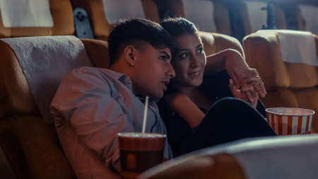 People audience watching movie in the movie theater cinema. Group recreation activity and entertainment concept.