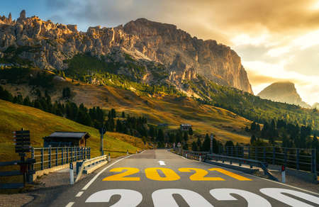 2021 New Year road trip travel and future vision concept . Nature landscape with highway road leading forward to happy new year celebration in the beginning of 2021 for fresh and successful start .