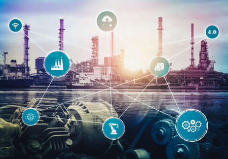 Industry 4.0 technology concept - Smart factory for fourth industrial revolution with icon graphic showing automation system by using robots and automated machinery controlled via internet network . Stockfoto