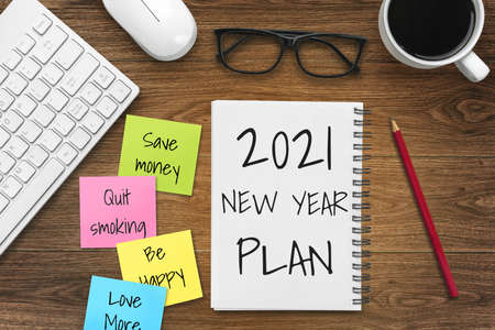 2021 Happy New Year Resolution Goal List - Business office desk with notebook written in handwriting about plan listing of new year goals and resolutions setting. Change and determination concept. Reklamní fotografie