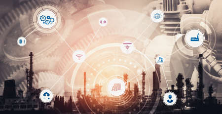 Industry 4.0 technology concept - Smart factory for fourth industrial revolution with icon graphic showing automation system by using robots and automated machinery controlled via internet network . Stock Photo