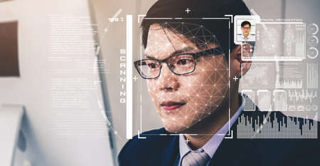 Facial recognition technology scan and detect people face for identification . Future concept interface showing digital biometric security system that analyze human face to verify personal data . Banque d'images
