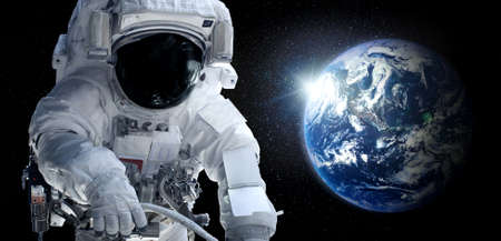 Astronaut spaceman do spacewalk while working for space station in outer space . Astronaut wear full spacesuit for space operation . Elements of this image furnished by space astronaut photos.